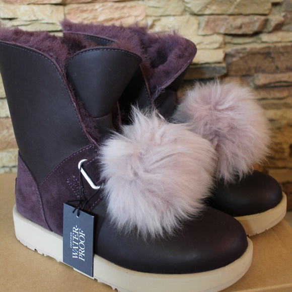 6d6bc3e5693 UGG ISLEY WATERPROOF LEATHER POM BOOTS Boutique